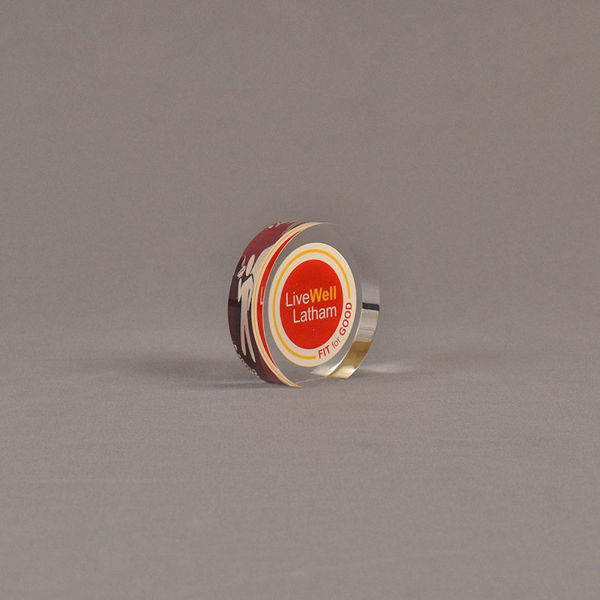 """Angle view of 2 1/2"""" circle acrylic embedment with full color image"""