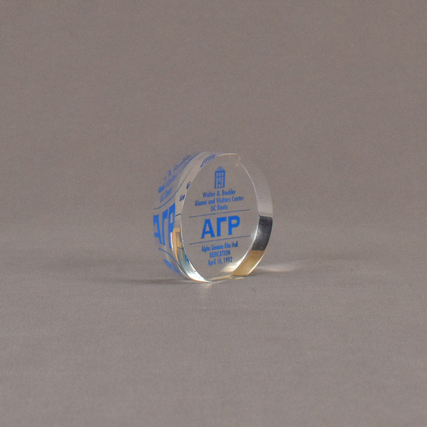 """Angle view of 3"""" circle acrylic embedment with blue image"""