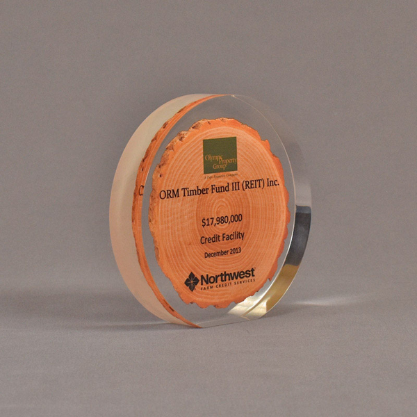 """Angle view of 5"""" circle acrylic embedment with printed wood chip"""