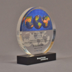 """Angle view of 6"""" circle acrylic embedment with full color globe image - shown with optional base."""