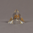 """Angle view of 3 1/2"""" x 4 1/2"""" pyramid acrylic embedment award with bronze images cast inside."""