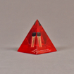 """Angle view of 3 1/2"""" x 4 1/2"""" pyramid acrylic embedment award with red tint and dirt sample cast inside."""