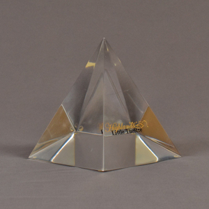"""Angle view of 5"""" x 6"""" pyramid acrylic embedment award with Highland Little Theatre text cast inside."""