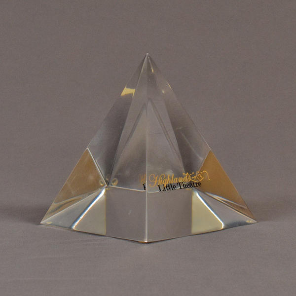 "Angle view of 5"" x 6"" pyramid acrylic embedment award with Highland Little Theatre text cast inside."
