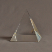 "Side view of 5"" x 6"" pyramid acrylic embedment award with Highland Little Theatre text cast inside."