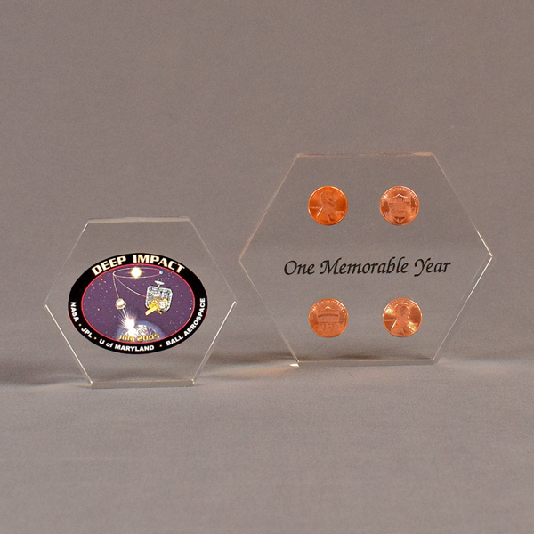 Two hexagon acrylic embedment awards one with cast pennies the other with cast printed Deep Impact design.
