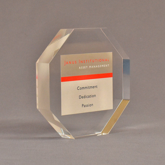 """Angle view of 5"""" x 5"""" hexagon acrylic embedment award with Janus Institutional Assets tagline cast in clear acrylic."""