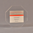 """Front view of 5"""" x 5"""" hexagon acrylic embedment award with Janus Institutional Assets tagline cast in clear acrylic."""