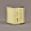 """Angle view of 3 1/4"""" prospectus book acrylic embedment award with document mounted in clear acrylic."""