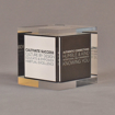 """Angle view of 3 1/2"""" cube acrylic embedment award with creative printed cube cast into clear acrylic."""