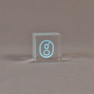 """Front view of 2"""" cube acrylic embedment award with G logo printed on clear acetate and cast in acrylic."""