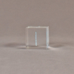"""Side view of 2"""" cube acrylic embedment award with G logo printed on clear acetate and cast in acrylic."""
