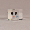 """Angle view of 2 1/2"""" cube acrylic embedment award with small piece of coal cast in clear acrylic."""