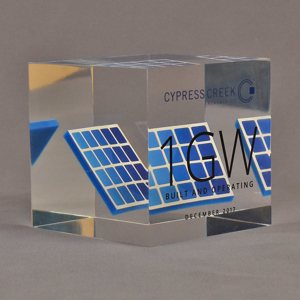 """Angle view of 4"""" cube acrylic embedment award with mock solar panel cast into crystal clear acrylic."""