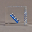 """Side view of 4"""" cube acrylic embedment award with mock solar panel cast into crystal clear acrylic."""