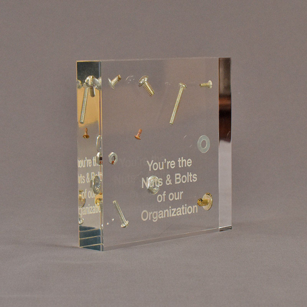 """Angle view of 5 1/2"""" square acrylic embedment award with nuts and bolts cast into crystal clear acrylic."""