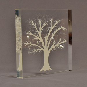 """Angle view of 7"""" square acrylic embedment award with Tree of Life cast into crystal clear acrylic."""