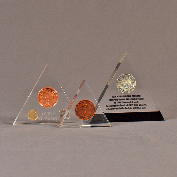 Three triangle acrylic embedment awards showing clarity of cast coins in crystal clear acrylic.