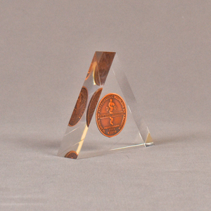 """Angle view of 4"""" triangle acrylic embedment award with copper coin mounted in clear acrylic."""
