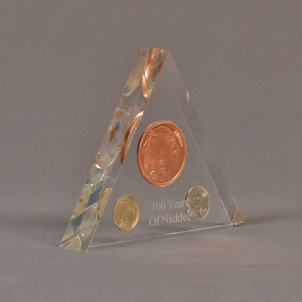 """Angle view of 5"""" triangle acrylic embedment award with 100 Years of US nickels cast in clear acrylic."""