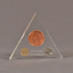 """Front view of 5"""" triangle acrylic embedment award with 100 Years of US nickels cast in clear acrylic."""
