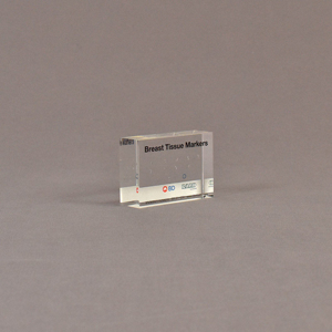 """Angle view of 2"""" x 3"""" rectangle acrylic embedment award with medical tissue markers cast in acrylic."""