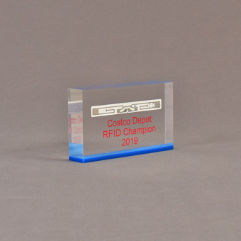 """Angle view of 3"""" x 5"""" rectangle acrylic embedment award with Costco Depot RFID Champion logo cast in acrylic."""