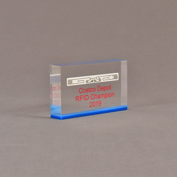 "Angle view of 3"" x 5"" rectangle acrylic embedment award with Costco Depot RFID Champion logo cast in acrylic."