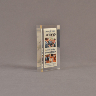 """Angle view of 3"""" x 6"""" rectangle acrylic embedment award with lawfully wed Arizona Republic newspaper cast in acrylic."""