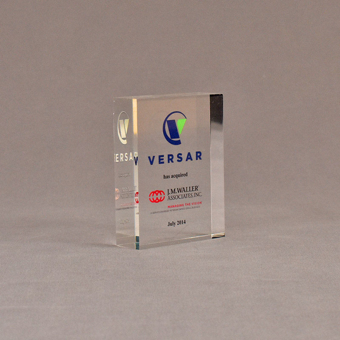 """Angle view of 3 1/2"""" x 3"""" rectangle acrylic embedment award with VERSAR logo and text cast into acrylic."""