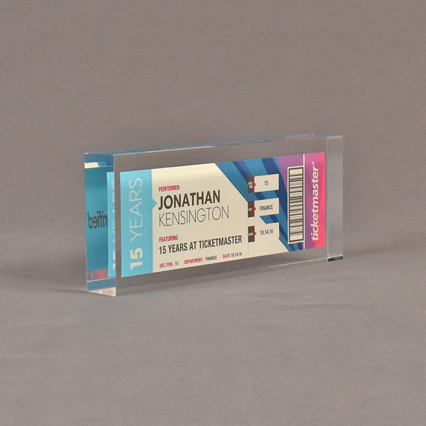 """Angle view of 3 1/2"""" x 7"""" rectangle acrylic embedment award with Ticketmaster ticket cast into crystal clear acrylic."""