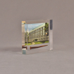 """Angle view of 4"""" x 4 1/2"""" rectangle acrylic embedment award with rusty nail and building photo cast into acrylic."""