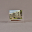 """Front view of 4"""" x 4 1/2"""" rectangle acrylic embedment award with rusty nail and building photo cast into acrylic."""