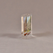 """Side view of 4"""" x 4 1/2"""" rectangle acrylic embedment award with rusty nail and building photo cast into acrylic."""