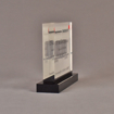 """Side view of 5"""" x 6"""" rectangle acrylic embedment award with CIT Railcar Litigation ruling cast into clear acrylic."""