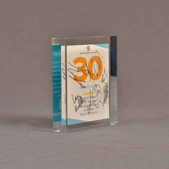 """Angle view of 5 1/2"""" x 6"""" rectangle acrylic embedment award with Sports Spectacular Top 30 Honorees cast in acrylic."""