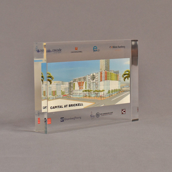 """Angle view of 5"""" x 7"""" rectangle acrylic embedment award with Capital at Brickwell logos cast into clear acrylic."""