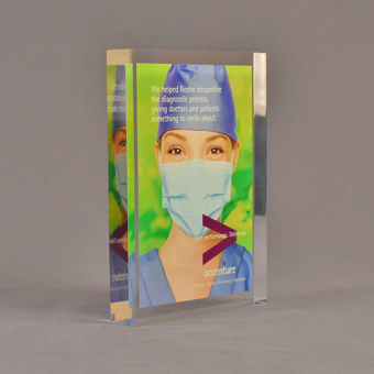 """Angle view of 5 1/2"""" x 7"""" rectangle acrylic embedment award with Accenture sales tool cast into crystal clear acrylic."""