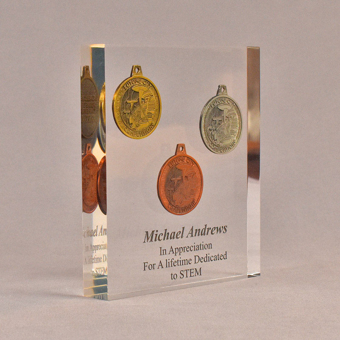 """Angle view of 6"""" x 7"""" rectangle acrylic embedment award with three Future City coins cast into crystal clear acrylic."""