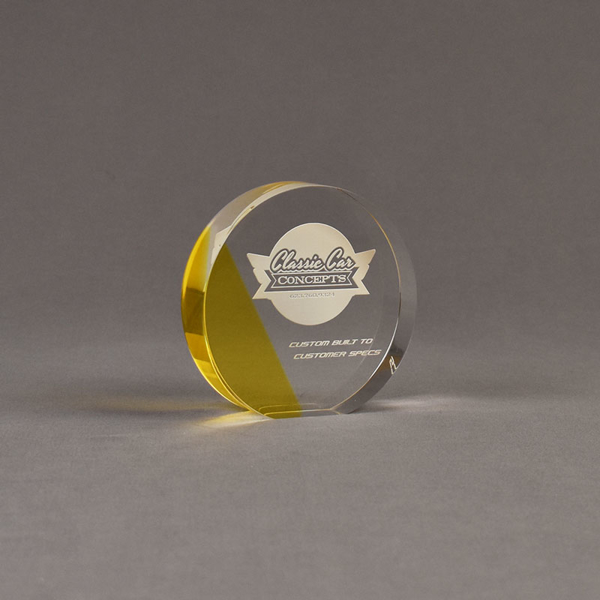 """Angle view of ColorCast™ 4"""" Circle Acrylic Award with yellow transparent color highlight showing trophy laser engraving."""