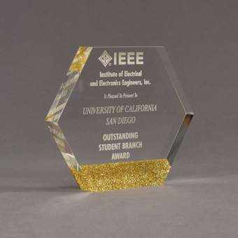 """Angle view of ColorCast™ 6"""" Hexagon Acrylic Award with gold glitter color highlight showing trophy laser engraving."""