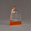 """Angle view of ColorCast™ 6"""" Obelisk Acrylic Award with transparent orange color highlight showing trophy laser engraving."""
