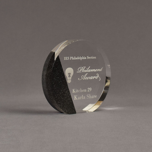 """Angle view of Composites™ 5"""" Circle Acrylic Award with Sanded Black Onyx Staron® accent showing trophy laser engraving."""