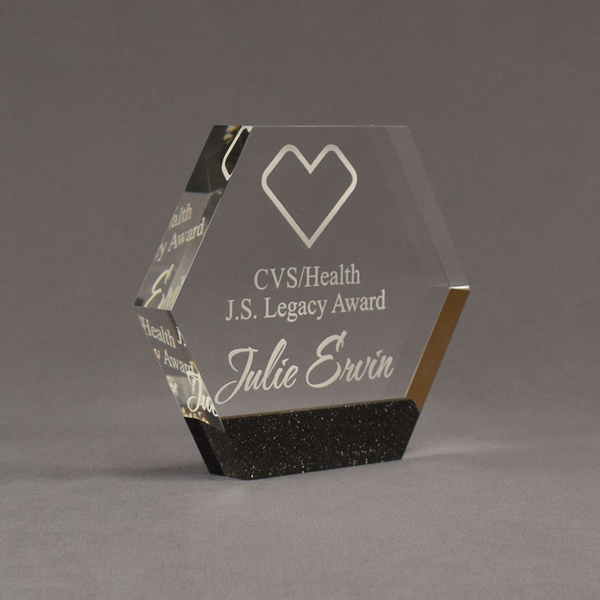 """Angle view of Composites™ 6"""" Hexagon Acrylic Award with Sanded Black Onyx Staron® accent showing trophy laser engraving."""