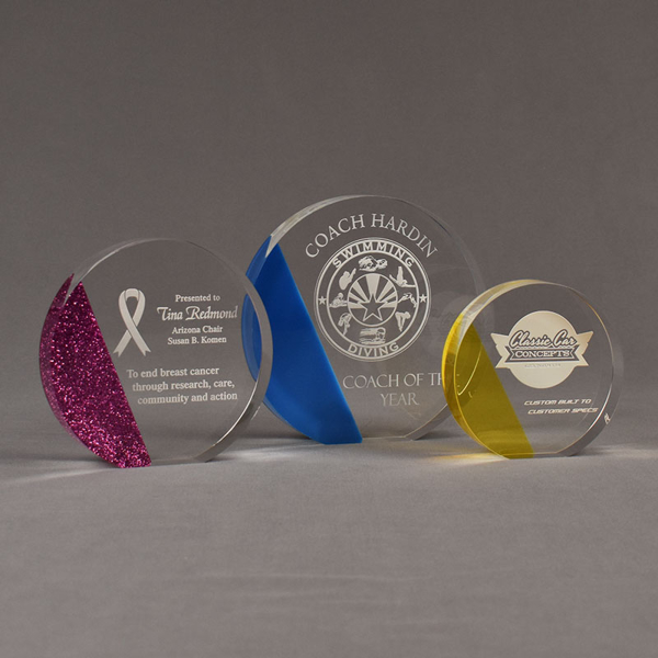 Three ColorCast™ Circle Acrylic Awards grouped showing pink glitter, blue transparent and yellow transparent accent color options.