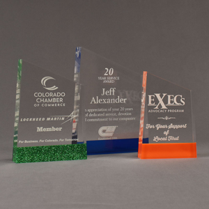 Three ColorCast™ Meridian Acrylic Awards grouped showing green glitter, blue transparent and orange accent color options.