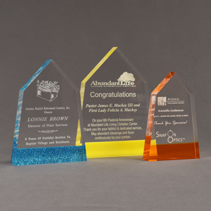 Three ColorCast™ Obelisk Acrylic Awards grouped showing blue glitter, yellow and orange transparent accent color options.