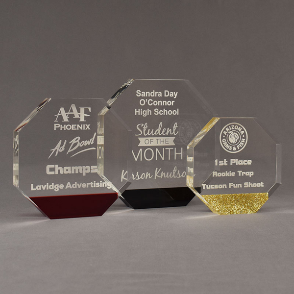 Three ColorCast™ Octagon Acrylic Awards grouped showing red transparent, black and gold glitter accent color options.