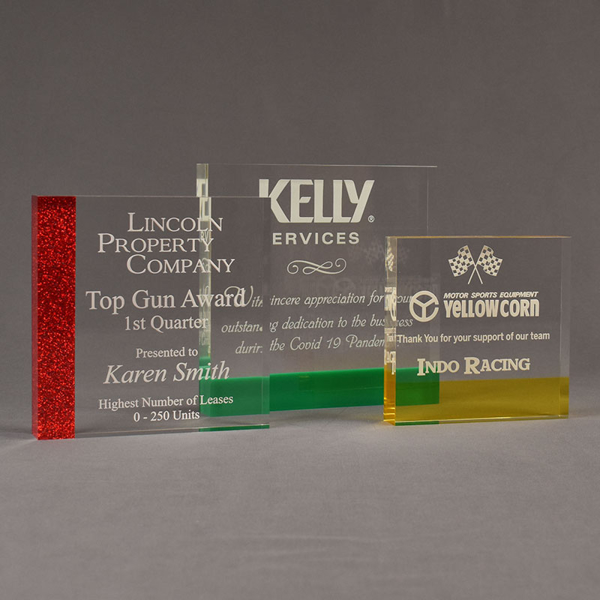 Three ColorCast™ Square Acrylic Awards grouped showing red glitter, green and transparent yellow accent color options.