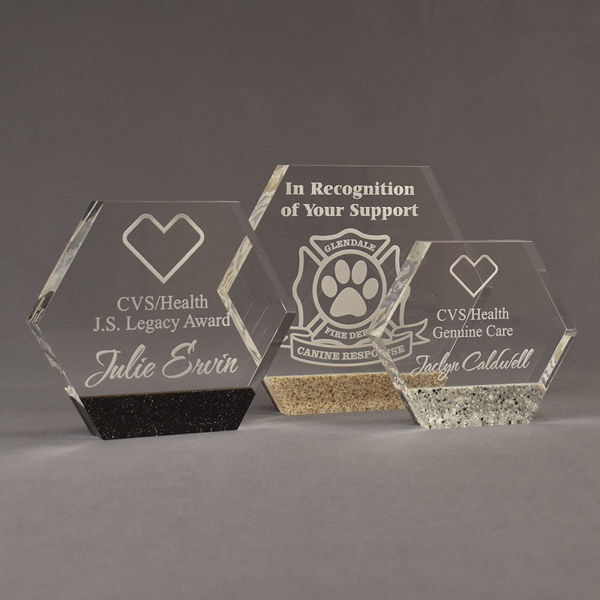 Three Composites™ Hexagon Acrylic Awards grouped showing Staron® Sanded Black Onyx, Aspen Brown and Platinum Grey accent options.
